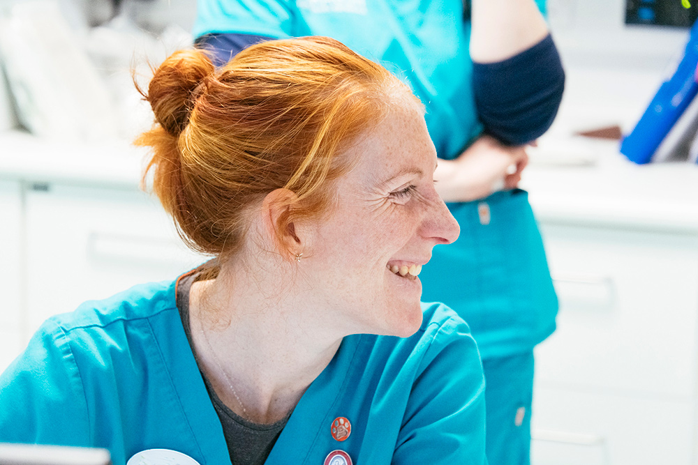 Side view of a veterinary nurse smiling